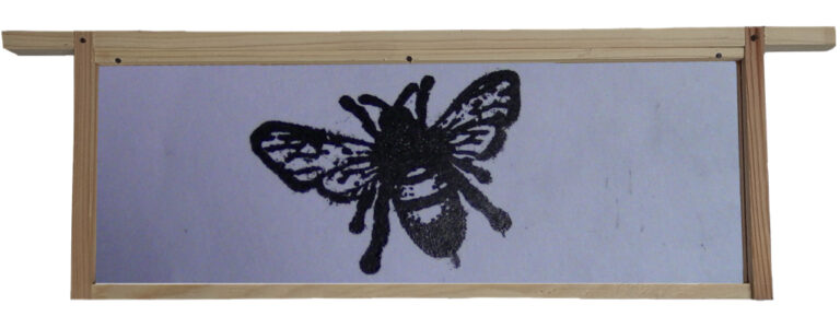 A Printed Honeybee inside a hive frame